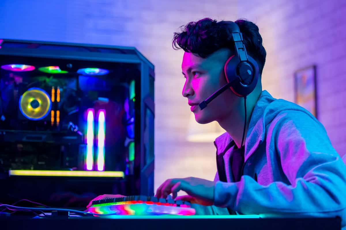 Photo of a determined competitive gamer with custom built gaming PC.